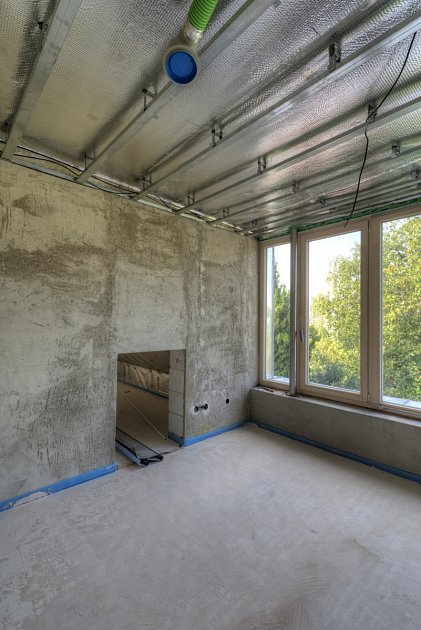 Rekonstrukce a nástavba domu ze 30. let