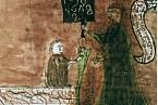Učitel píše na tabuli arabské číslice.