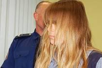 Žena obviněná z vraždy čtyř dětí.