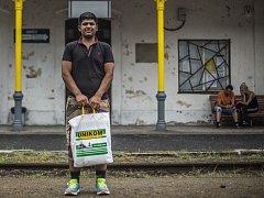 Migrant na nádraží.