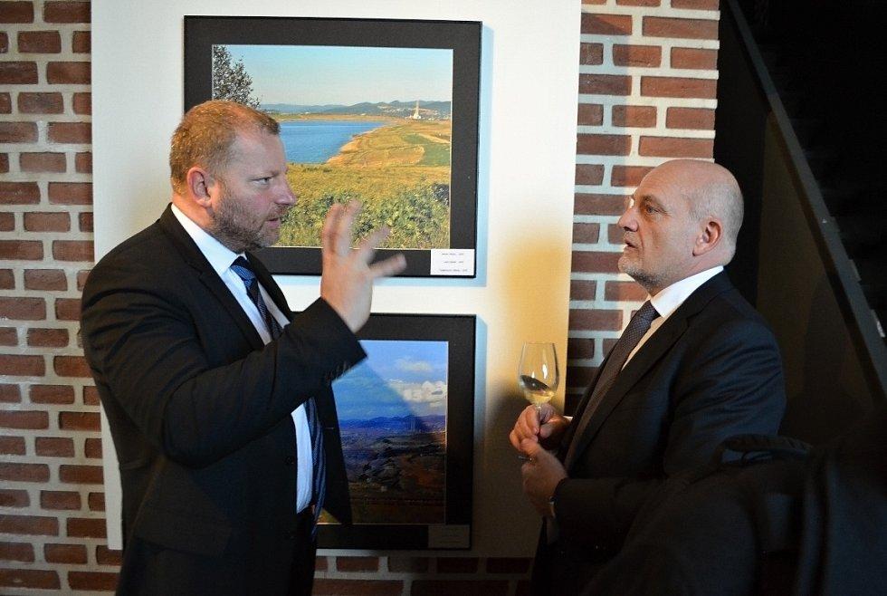 Jan Dienstl ze Severní energetické, majitel dolu u Horního Jiřetína a vinařství ve Třebívlicích. Výstava o Mostecku na Hradčanech.