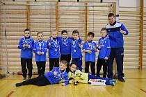 Mladí fotbalisté z Mosteckého fotbalového klubu a trenér Tomáš Rain se úspěšně představili na turnaji v Ústí.