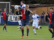 Louny (v bílém) versus Souš. Domácí vyhráli 3:0.