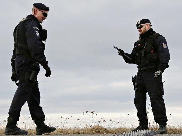 Policisté.