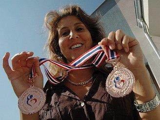 Petra Vovesná se svými medailemi.