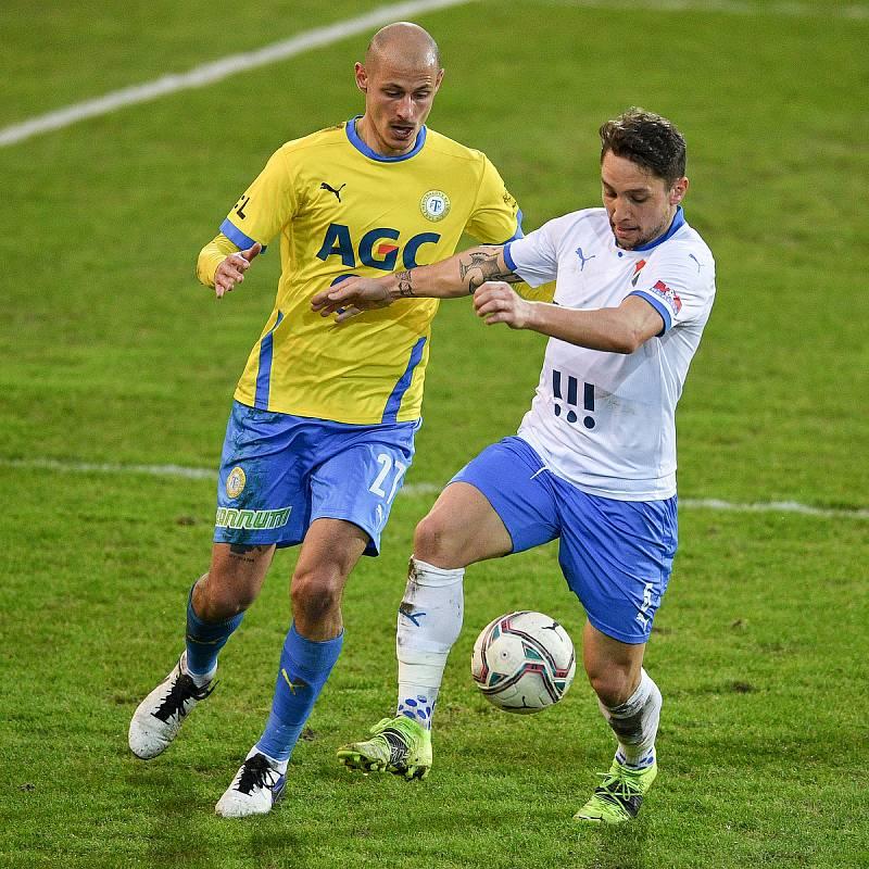 Utkání 21. kola první fotbalové ligy: FC Baník Ostrava – FK Teplice, 27 února 2021 v Ostravě. (zleva) Tomáš Kučera z Teplic a Adam Jánoš z Ostravy.