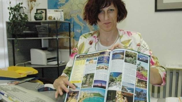 V cestovní kanceláři