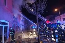 Požár domu s obchodem v Duchcově