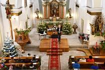 Modlanský kostel sv. Apolináře. Konají se tam kulturní akce.