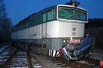 Z místa nehody osobního auta a vlaku.