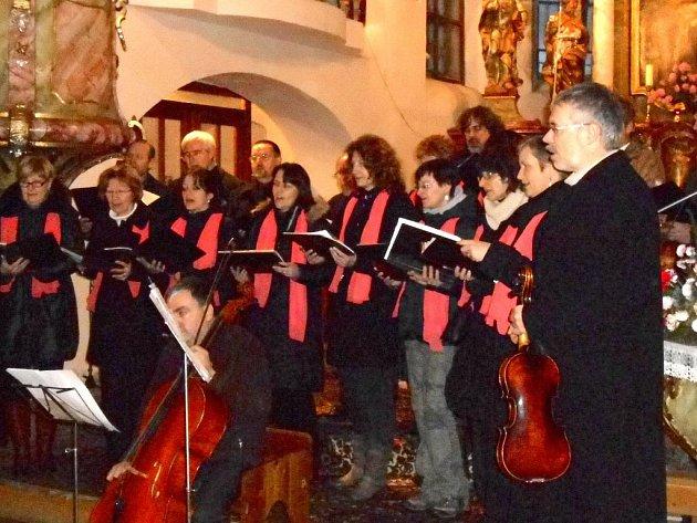 Adventní koncert  Scholy U redemptoristů v kostele sv. Mikuláše ve Kdyni.