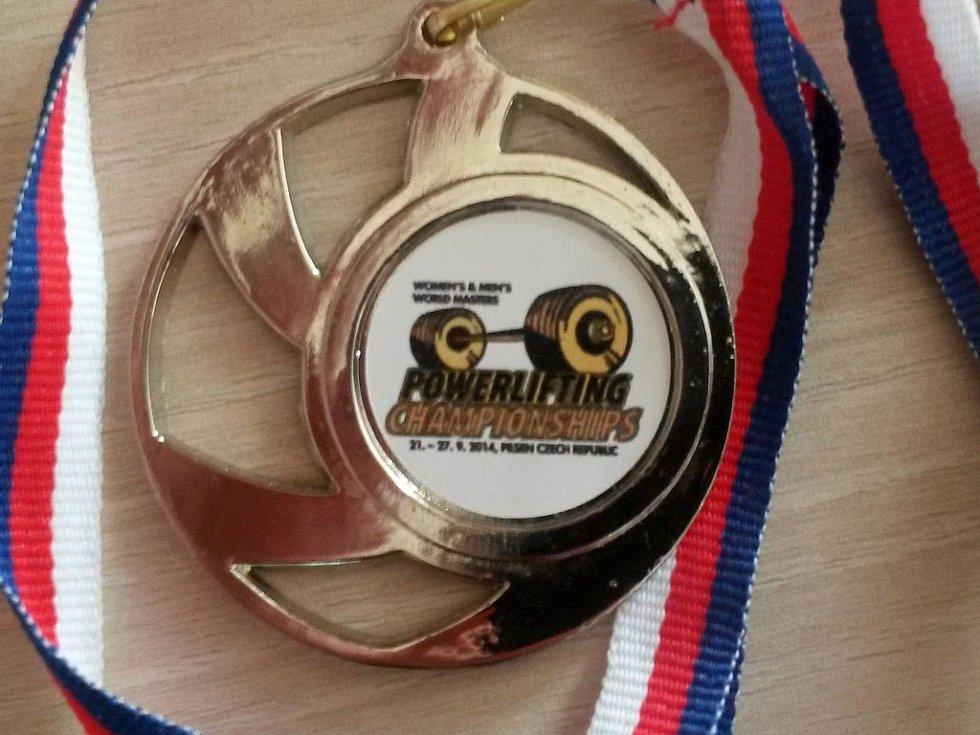Mistrovství světa v silovém trojboji - účastnická medaile.