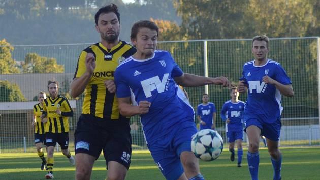 David Vitebský (na archivním snímku v modrém) se o víkendu zaskvěl parádním gólem.