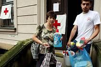 Humanitární pomoc pro oběti postižené povodněmi.