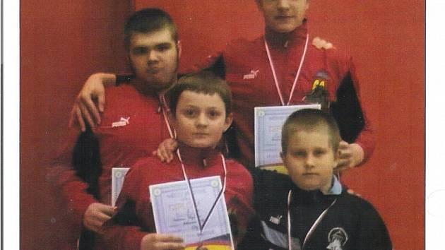 Zápasníci Sokola M. Lázně: nahoře zleva Matěj Pinc a Roman Kořán, dole zleva Adam Ulrych a Jiří Coufal.