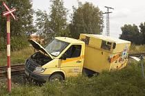 Následky srážky vlaku a dodávkového automobilu na železničním přejezdu nedaleko od Třebeně na Chebsku