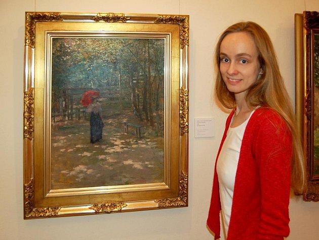 MARTINA CHURÁ, ASISTENTKA  ŘEDITELE  GVU, se Deníku vyzpovídala přímo v expozici vedle obrazu z roku 1896 s názvem Dáma s červeným slunečníkem.