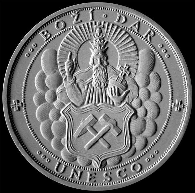 Pamětní medaile k500. výročí ražby šlikovských tolarů a 1.výročí zápisu Krušnohoří do seznamu UNESCO byla pokřtěna vBožím Daru.