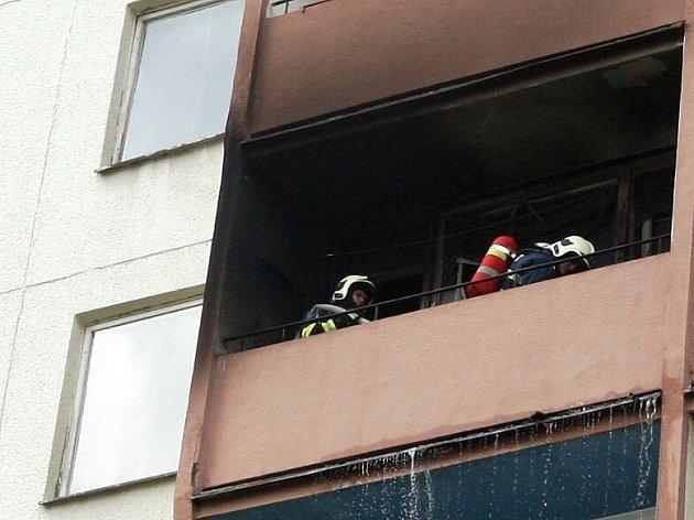 Požár v bytě.