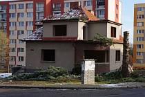 Místo, kde vyroste bytový dům.