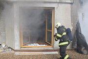 Požár novostavby v Benešově.