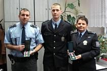 TROJICE oceněných policistů z oddělení v Unhošti.