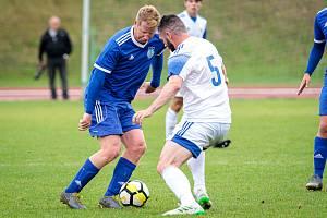 Fotbalová příprava: Kladno (v bílém) nečekaně vyhrálo na hřišti SK Slaný vysoko 7:1. Josef Galbavý
