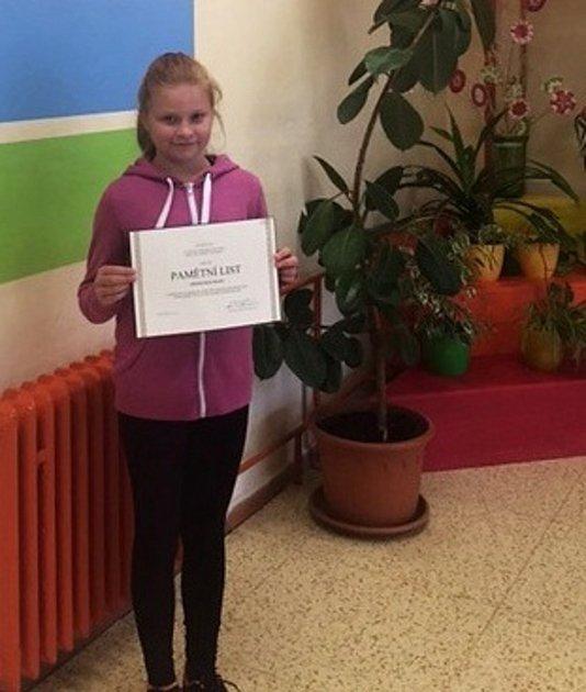 Klárka Tichavová ze Smečna obsadila se svojí krásnou panenkou druhé místo.