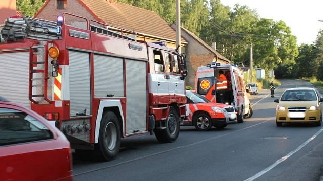 Nedělní nehoda skútru a bicyklu ve Slaném-Kvíčku