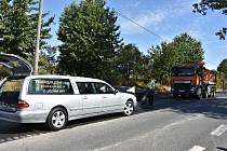 Při opravě silnice u Slaného zahynul dělník.