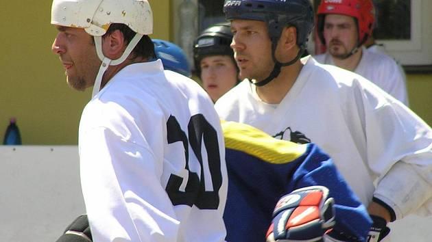 Rostislav Ježek (vlevo) ještě v barvách Buštěhradu. V létě se ale vrátil do svého mateřského klubu Jungle Fever.