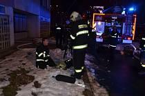 Požár v bytě v Kročehlavech