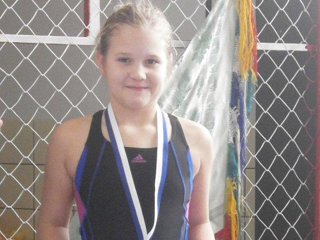 Karolína Bezpalcová plavala poprvé v Domažlicích na závodech stovku a hned brala bronz.