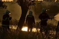Požár stohu mezi Pečkami a Ratenicemi