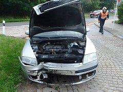 Řidička s autem narazila do plotu