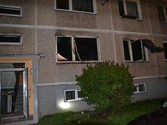 Požár v bytě panelového domu.