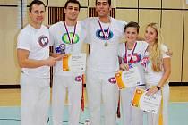 CAPOEIRA LIBEREC. Zleva trenér Tomáš Zummer, Tomáš Drahorád, Petr Švéda, Alice Avci, Beata Nejezchlebová.