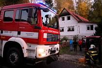 Požár střechy domu v Harcově.