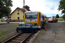 Střet vlaku a automobilu u Hrubé Skály.