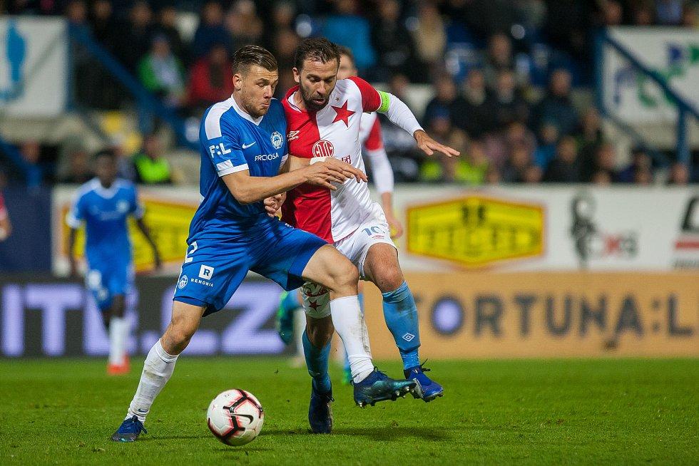 Zápas 12. kola první fotbalové ligy mezi týmy FC Slovan Liberec a SK Slavia Praha se odehrál 21. října na stadionu U Nisy v Liberci. Na snímkuzleva Radim Breite a Josef Hušbauer.