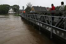 VIŠŇOVÁ. Ještě večer na Svatého Václava opouštěli obyvatelé Višňové ze strachu před velkou vodou své domovy.