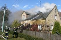 Příčinou vzniku požáru byla s největší pravděpodobností hra dětí s otevřeným ohněm.