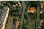 Povodně na Moravě v roce 1997 objektivem Deníku. Litovel, kde pomáhali při evakuaci obyvatel i jindřichohradečtí záchranáři.