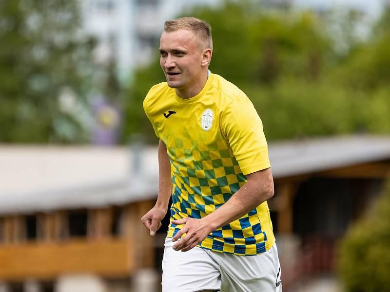 Jindřichohradečtí fotbalisté (ve žlutém) vstoupili do nového ročníku divize s výraznými změnami v kádru.