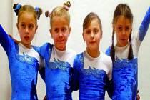 ÚSPĚCH. Dobře si vedly gymnastky z kategorie miniligy ve složení (zleva) Míša Willmannová, Kristýnka Vondrášková, Andrejka Zwettlerová, Markétka Procházková.