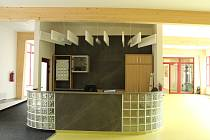 Přímo za recepcí byla vybudována i zasedací místnost.
