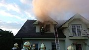 Požár v pokoji jednopatrového rodinného domu v Chrustenicích.