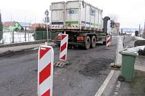 Zničená silnice v Tlustici