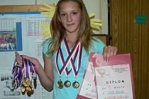 Miloslava Budínská už získala ve sportovních soutěžích pěknou sbírku medailí.