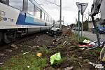 Nehoda na železničním přejezdu v Dolanech u Prahy.